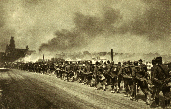 On June 23rd Grodno was taken after hard fight - German troops are moving in the burning town