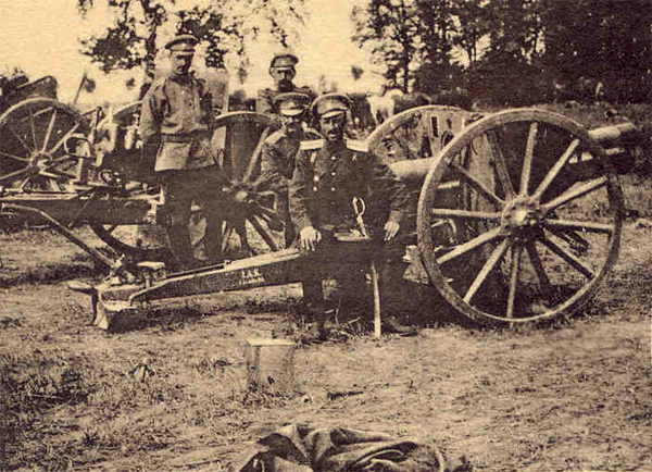 Captain the Baron de Wrangel sitting on one of the field guns taken from the Germans on August 6/19lh., 1914