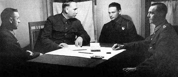 Don Front HQ. From left to right: General K. Rokossovsky, Marshal of Artillery N. Voronov, translator Major Diatlenko, and Field Marshal von Paulus, who was taken prisoner by the troops of the 64th army under General N. Shumilov