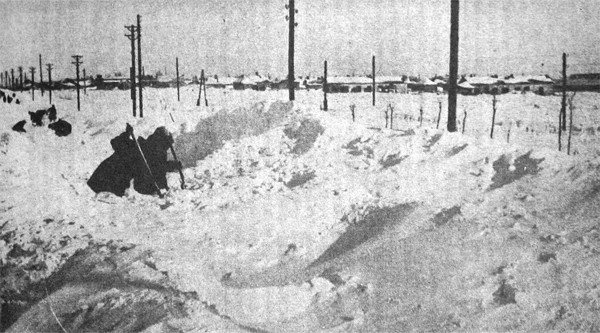 RUSSIAN CIVILIANS, clearing drifted snow, Ukraine, 1942